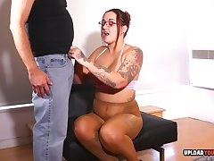 Tattooed bimbo strokes a very hard penis