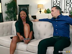 Ebony beauty soaks her face in the white man's load
