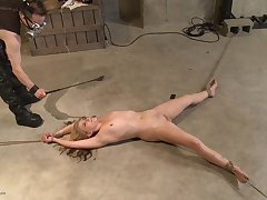 After he is done whipping her he covers her body with hot wax