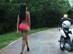 Wearing despondent pink bikini transsexual ladyboy Taiira Navarrete brags off her booty