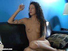 Tattooed matured cougar smoking while displaying her inept tits