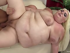 Mature blonde floozy spreads her fat legs to get fucked by a long cock