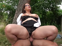 Heavy ass mature rides dick in a park together with swallows