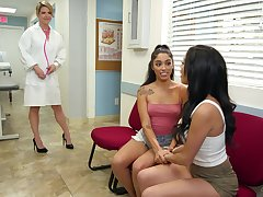 Sexy womanlike doctor Kit Mercer is fucking two beautiful lesbians
